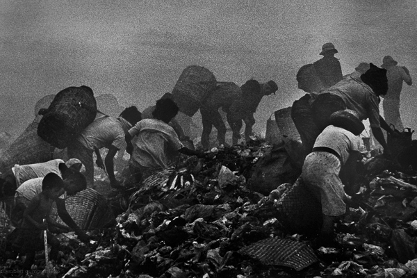 Manila, Philippines 1987: Recyclers working on Manila's Smoking Mountain dump collecting material to be recycled.