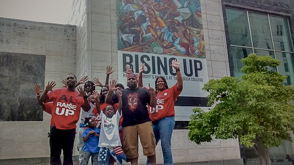 "Some ""Raise Up for $15"" workers and family unwind after rally outside Birmingham City Hall.  Photo: Joe Keffer"