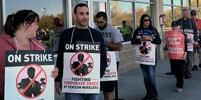 11 May 2016, Everett MA: Picketing the Verizon Wireless store.  Photo: Rand Wilson