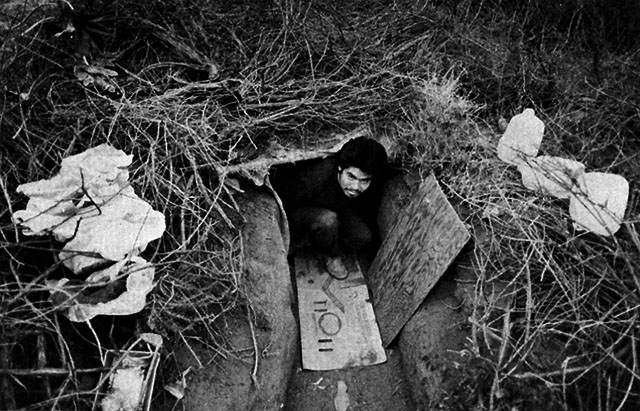 Migrant Mexican farmworker living in a trench.  Photographer and date unknown.  Location: California